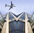 Airplane and the modern building Stock Photo