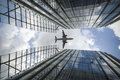 Airplane and modern buildings Royalty Free Stock Photo