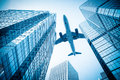 Airplane and modern office building Royalty Free Stock Photo