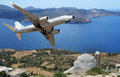 Airplane over a greek insland flying the island Stock Photos