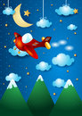 Airplane over the mountain by night Royalty Free Stock Images