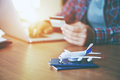Airplane with passports near paying with credit card Royalty Free Stock Photo