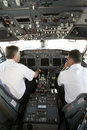 Airplane pilots in cockpit preparing to takeoff Royalty Free Stock Photo