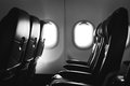 Airplane seat and window inside an aircraft Royalty Free Stock Photo