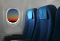 Airplane seat window inside aircraft view new moon sunset Royalty Free Stock Photos