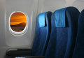 Airplane seat and window inside an aircraft with view on sea in croatia Stock Photos