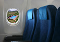 Airplane seat and window inside an aircraft with view on sea in croatia Stock Photo