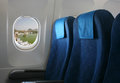 Airplane seat and window inside an aircraft with view on sea in croatia Royalty Free Stock Photography