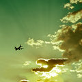 Airplane silhouette in beautiful sky cloudy sunset Stock Photo