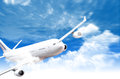 Airplane in sky Stock Image