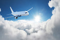 Airplane in the sky - Passenger Airliner / aircraft Royalty Free Stock Photo