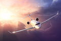 Airplane in the sky at sunset Royalty Free Stock Photo