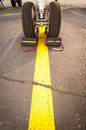 Airplane tires on yellow line Royalty Free Stock Photo