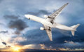 Airplane transportation jet air plane flies in blue sky Stock Image