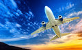 Airplane transportation jet air plane flies in blue sky Stock Photos