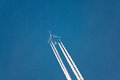 Airplane vapor trails Royalty Free Stock Photo