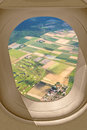 Airplane window view through at a golf course fields and meadows Royalty Free Stock Photos