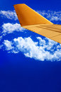 Airplane wing and blue sky Royalty Free Stock Image