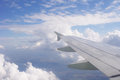 Airplane wing and blue sky with clouds Royalty Free Stock Photo