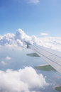 Airplane wing and blue sky with clouds Stock Photos