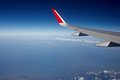 Airplane wing and blue sky Royalty Free Stock Photo