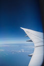 Airplane wing and blue sky outside the window | Beautiful high view aerospace Royalty Free Stock Photo