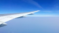 Airplane wing and clean blue sky Royalty Free Stock Photo