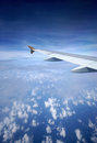 Airplane wing in flight on the sky Stock Photos
