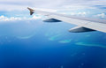 Airplane wing in flight on the sky Royalty Free Stock Photo