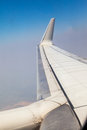 Airplane wing on sky background Stock Photography
