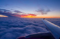 Airplane wing sunrise sky landscape Royalty Free Stock Image