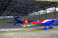 Airplanes inside a big hangar small blue plane Royalty Free Stock Photos