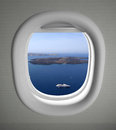 Airplanes window seat view with sea scape and islands Royalty Free Stock Photos