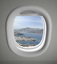 Airplanes window seat view with sea scape and some land Royalty Free Stock Images