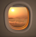 Airplanes window seat view with sunset sunrise Stock Photos