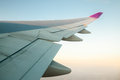 Airplanes wing sunrise with from its windows Stock Images
