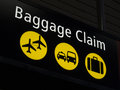 Airport baggage claim sign directing passengers to various areas of the Royalty Free Stock Images