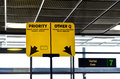 Airport boarding gate mark priority and other lane at the Royalty Free Stock Image