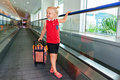 In airport child with luggage walk to plane boarding gate Royalty Free Stock Photo