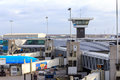 Airport control tower and gates Royalty Free Stock Photo