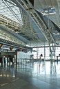 Airport counters spacious check in area with in a modern architecture style and natural light Stock Images