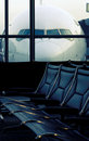 Airport empty seats with in background ready to fly Royalty Free Stock Images
