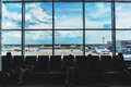 Airport hall or terminal. Big window with view of sky with clouds and planes Royalty Free Stock Photo