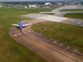 Airport landing airplane waiting to take off in an from above Royalty Free Stock Images