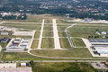 Airport landing strip from above aerial view seen in an the concrete runway is where an airplane can take off and land Royalty Free Stock Photos