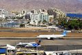 Airport and luxurious hotels in eilat israel may plane of israeli airline arkia landed at the of on the background of on may Stock Image