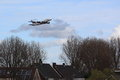 Airport noise big aircraft over houses near can be used to depict Stock Images