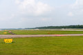 Airport runway with departing airplane on background Royalty Free Stock Images
