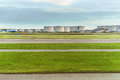 Airport runway in front of Fuel Storage Tanks and industrial storage site. Royalty Free Stock Photo