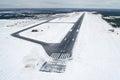 Airport Runway takeoff airplane flight travel sky clouds snow winter Siberia Royalty Free Stock Photo